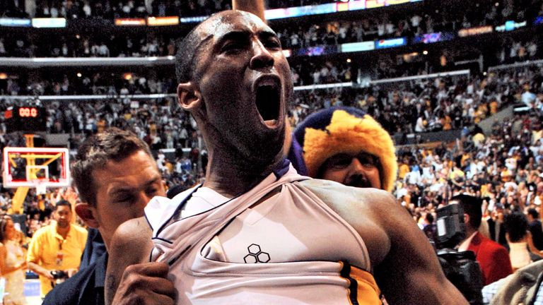 Kobe Bryant celebrates after hitting a game-winning shot against the Phoenix Suns in a 2006 playoff series