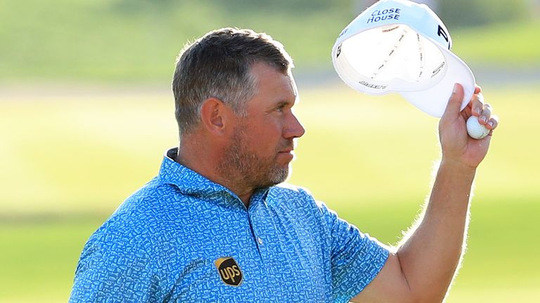 Lee Westwood resists triple threat of triumph in Abu Dhabi