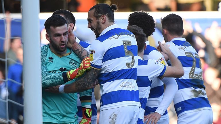 QPR's Liam Kelly is mobbed by team-mates after saving Patrick Bamford penalty