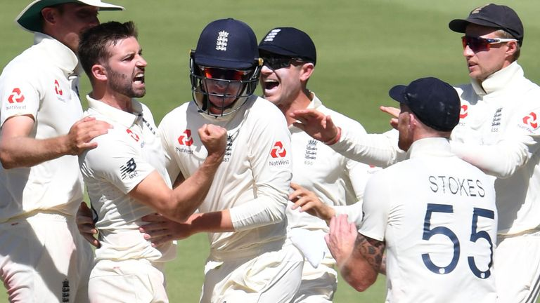 JOHANNESBURG, SOUTH AFRICA - JANUARY 27: Mark Wood and Ollie Pope of England celebrates the wicket of Rassie van der Dussen of the Proteas during day 4 of the 4th Test match between South Africa and England at Imperial Wanderers Stadium on January 27, 2020 in Johannesburg, South Africa. (Photo by Lee Warren/Gallo Images)