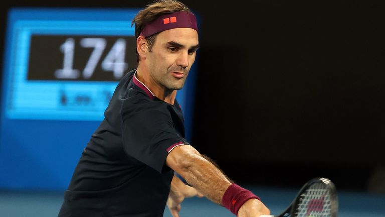 Switzerland's Roger Federer hits a return against Australia's John Millman during their men's singles match on day five of the Australian Open tennis tournament in Melbourne on January 24, 2020