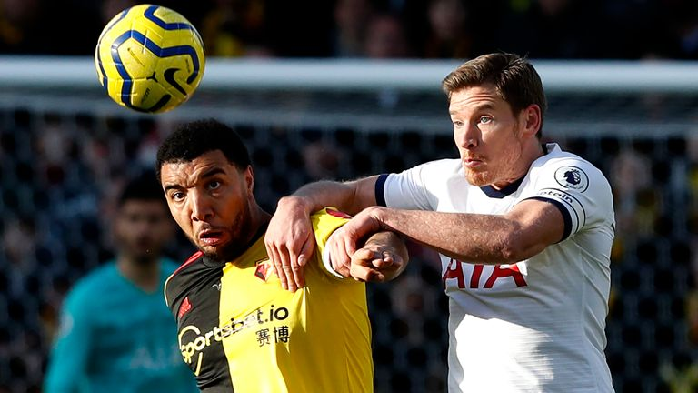 Troy Deeney competes for possession with Jan Vertonghen