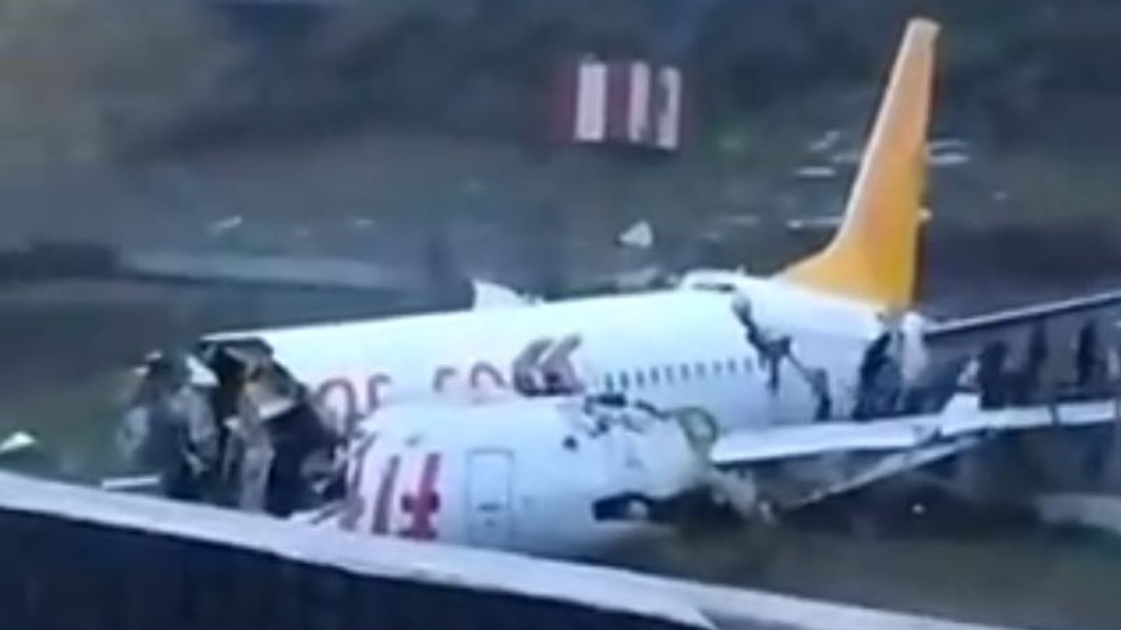 Plane splits in three after skidding off Istanbul runway