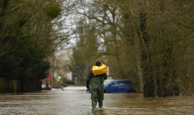 UK weather: More than 90 flood warnings in place as heavy rain continues to fall