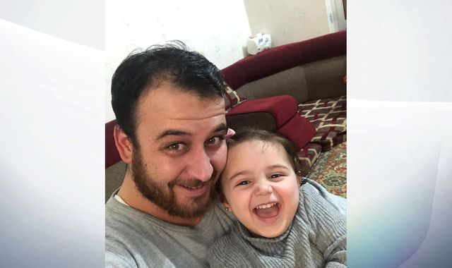 'Heroic' dad teaches little girl to laugh as bombs fall in Syria