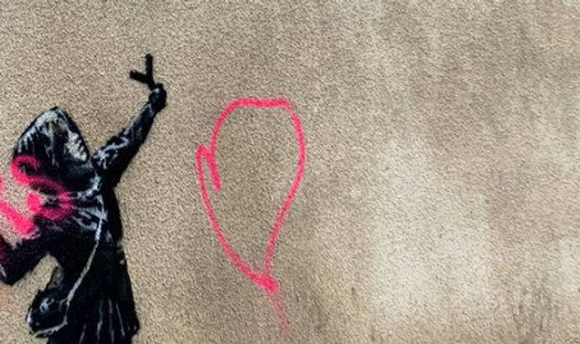 Banksy artwork of girl firing flowers from slingshot is vandalised in Bristol