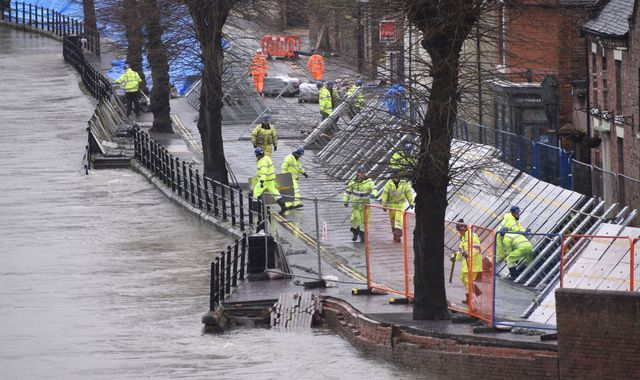 UK weather: Storm Jorge forces flood-hit towns to put up temporary barriers