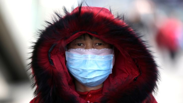 A woman wearing a face mask in Beijing, China