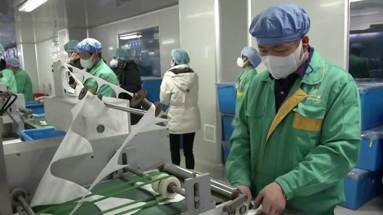 A worker makes face masks