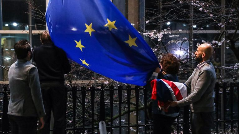 A staff member carries the  United Kingdom's flag after taking it down from the European Parliament building in Brussels on Brexit Day, January 31, 2020. - Britain leaves the European Union at 2300 GMT on January 31, 2020, 43 months after the country voted in a June 2016 referendum to leave the block. The withdrawal from the union ends more than four decades of economic, political and legal integration with its closest neighbours. (Photo by Aris Oikonomou / AFP) (Photo by ARIS OIKONOMOU/AFP via Getty Images)