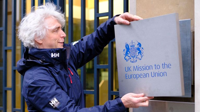 BRUSSELS, BELGIUM - FEBRUARY 1, 2020: A United Kingdom official changes the plaque from 'Permanant Representation to the EU Brussels' for 'UK Mission to the European Union' on February 1, 2020 in Brussels, Belgium. The United Kingdom left the EU on Friday at midnight, January 31st. (Photo by Thierry Monasse/Getty Images)