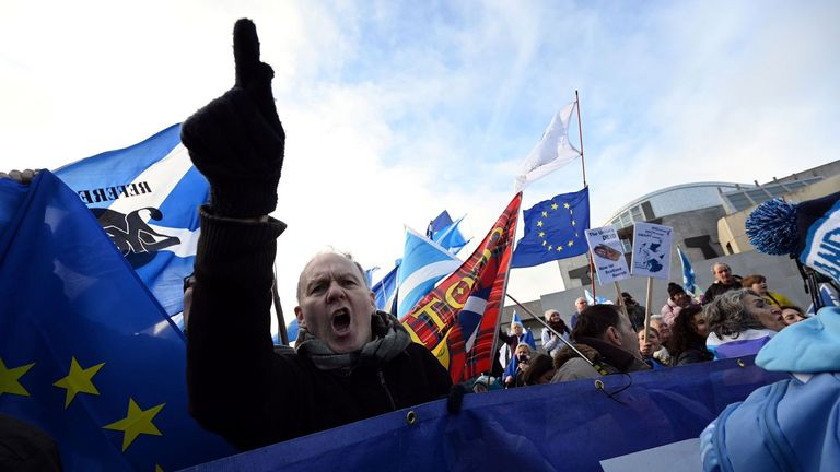 Activists attend an anti-Conservative government, pro-Scottish independence, and anti-Brexit demonstration outside Holyrood, the seat of the Scottish Parliament in Edinburgh on February 1, 2020. - Britain began its post-Brexit uncertain future outside the European Union on Saturday after the country greeted the historic end to almost half a century of EU membership with a mixture of joy and sadness. There were celebrations and tears on Friday as the EU's often reluctant member became the first to leave an organisation set up to forge unity among nations after the horrors of World War II. (Photo by Andy BUCHANAN / AFP) (Photo by ANDY BUCHANAN/AFP via Getty Images)