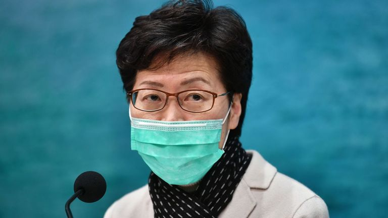 Hong Kong's Chief Executive Carrie Lam takes part in a press conference while wearing a facemask in Hong Kong on January 28, 2020, to update the territory on the situation concerning the SARS-like virus that has infected at least eight in the city and killed at least 106 people in mainland China. - Eight people are known to have the disease in Hong Kong, which of those, six arrived via a newly built high-speed train terminal that connects the city to the mainland. (Photo by Anthony WALLACE / AFP) (Photo by ANTHONY WALLACE/AFP via Getty Images)