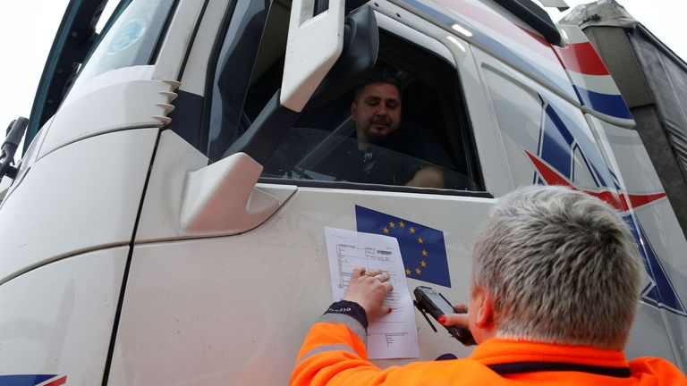 "An operator of the Channel Tunnel scans customs declaration form of a trucker during a ""no deal"" Brexit check simulation at the pit zone in Eurotunnel terminal in Coquelles, France, March 28, 2019. REUTERS/Pascal Rossignol"