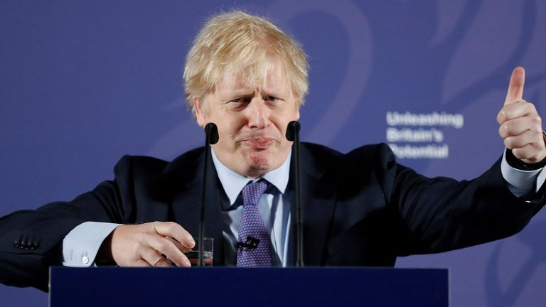 "Britain's Prime Minister Boris Johnson reacts as he delivers a speech at the Old Royal Naval College in Greenwich, south east London on February 3, 2020. - Britain on Monday said it wanted a ""thriving trade and economic relationship"" with the European Union, as it set out its position for future trade talks after it left the bloc. But Prime Minister Boris Johnson pledged: ""We will not engage in some cut-throat race to the bottom. We are not leaving the EU to undermine European standards. We will not engage in any kind of dumping, whether commercial, social or environmental."" (Photo by Frank Augstein / various sources / AFP) (Photo by FRANK AUGSTEIN/AP/AFP via Getty Images)"