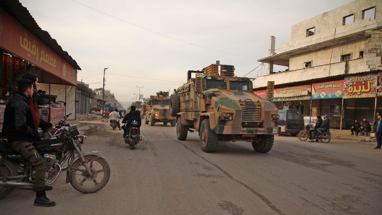 Turkish military vehicles drive in a convoy headed for the south of Idlib province as they pass by the town of Atareb in the western countryside of Aleppo on February 3, 2020. (Photo by AAREF WATAD / AFP) (Photo by AAREF WATAD/AFP via Getty Images)
