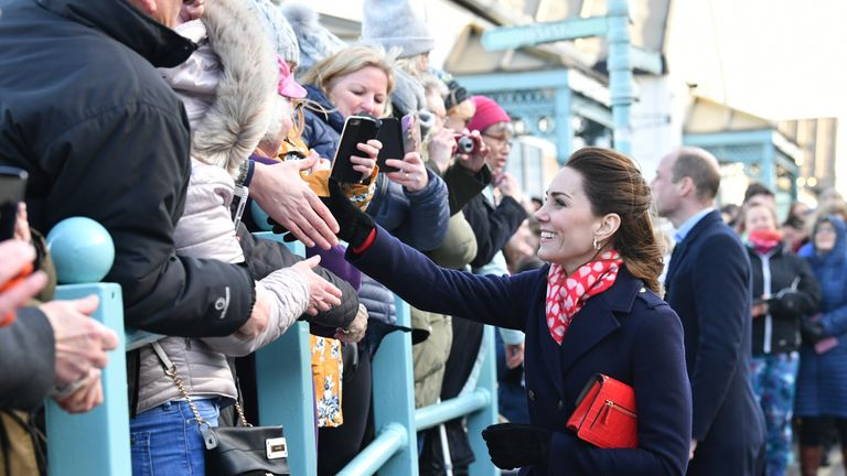 The Duchess of Cambridge speaks with people in the crowd as she leaves the RNLI Mumbles Lifeboat Station, near Swansea in south Wales.