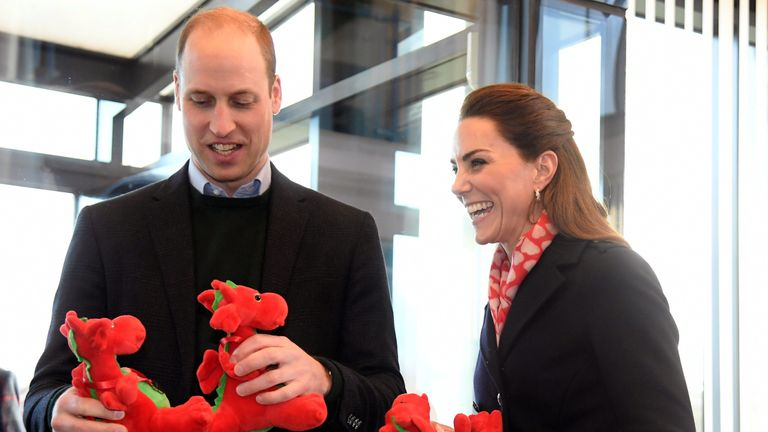The Duke and Duchess of Cambridge, holding dragon toys they received for their children, during a visit to Tata Steel in Port Talbot in south Wales.