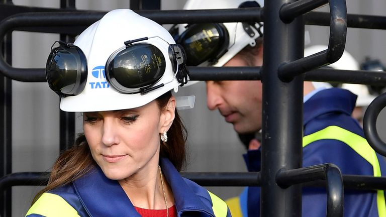 The Duke and Duchess of Cambridge go through a turnstile during a visit to Tata Steel in Port Talbot in south Wales.