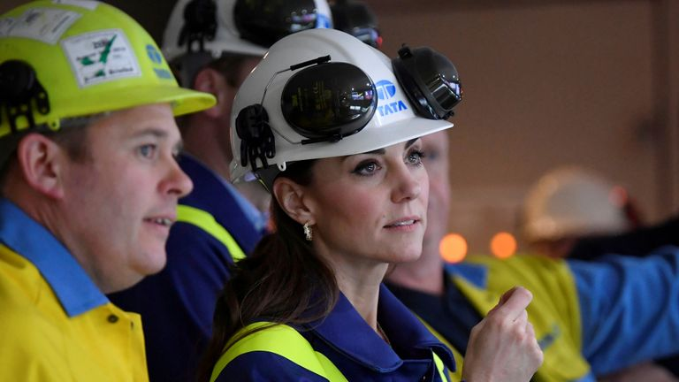 The Duchess of Cambridge inspects operations with works manager Carl Banfield at the control centre during a visit to Tata Steel in Port Talbot in south Wales.