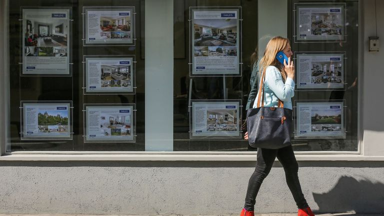A woman walks past adverts in the window of an estate agent in London on August 17, 2016  From computers and cars to carpets and food, Britain's decision to leave the EU is beginning to hit consumers in the pocket, having already spread uncertainty through the property market. There are fears over the UK housing market, but deflation is more of a concern than price rises in this key sector. Figures released Monday showed that residential rents for new lets in London had fallen for the first time in six years. In addition, homeowners have seen the value of their property rise on average by just 2.1 percent in the year up tol August, a slowdown from the breakneck growth of recent years, according to property website Rightmove.  / AFP / DANIEL LEAL-OLIVAS        (Photo credit should read DANIEL LEAL-OLIVAS/AFP via Getty Images)
