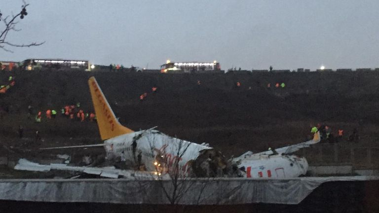 "This picture taken on February 05, 2020, shows a Pegasus airlines boeing 737 plane after it skidded off the runway at Istanbul's Sabiha Gokcen airport. - A plane carrying 171 passengers skidded off the runway at an Istanbul airport and split into two after landing in rough weather on February 05, but officials said no-one had died. The aircraft had flown into Istanbul's Sabiha Gokcen airport from the Aegean city of Izmir in very wet weather, NTV broadcaster reported. At least 21 people were injured and taken to hospital, Istanbul Governor Ali Yerlikaya said on Twitter. ""Efforts to evacuate those affected continue,"" he added. (Photo by Muhammed DEMIR / AFP) (Photo by MUHAMMED DEMIR/AFP via Getty Images)"