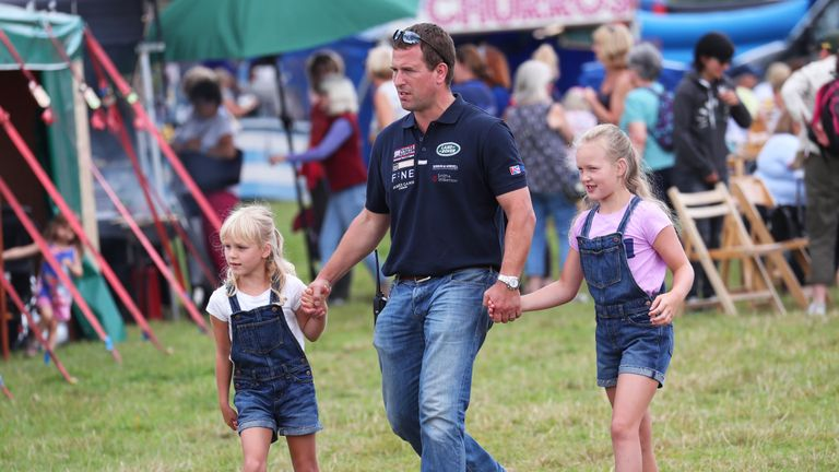 RETRANSMITTING AMENDING NAME SAVANNAH TO ISLA CORRECT CAPTION BELOW Peter Phillips with his children Isla (left) and Savannah during the Festival of British Eventing at Gatcombe Park, Gloucestershire.