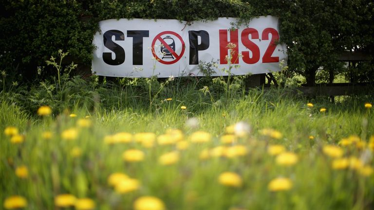 LYMM, UNITED KINGDOM - APRIL 28:  Stop HS2 posters mark the point where the proposed route of the new HS2 high speed rail link will pass through near to the village of Warburton on April 28, 2014 in Lymm, United Kingdom.  The House of Commons will vote later today on the HS2 bill's second reading with 30 Conservative MPs threatening to vote against the Government's pro-HS2 stance.  (Photo by Christopher Furlong/Getty Images)