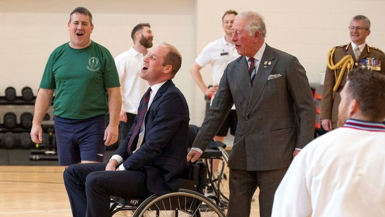 Britain's Prince Charles, Prince of Wales (3R) consoles his son Britain's Prince William, Duke of Cambridge (C), after he threw a basketball from a wheelchair, but failed to get it into the hoop, during their visit to the Defence Medical Rehabilitation Centre (DMRC) in Loughborough, central England on February 11, 2020. - The DMRC currently provides services to a small group of veterans in the form of the Complex Prosthetic Assessment Clinic (CPAC), which is a joint MOD and NHS England commissioned outpatient clinic. (Photo by Richard Pohle / POOL / AFP) (Photo by RICHARD POHLE/POOL/AFP via Getty Images)