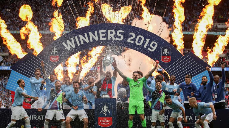 LONDON, ENGLAND - MAY 18: Vincent Kompany of Manchester City lifts the trophy following the FA Cup Final match between Manchester City and Watford at Wembley Stadium on May 18, 2019 in London, England. (Photo by Richard Heathcote/Getty Images)