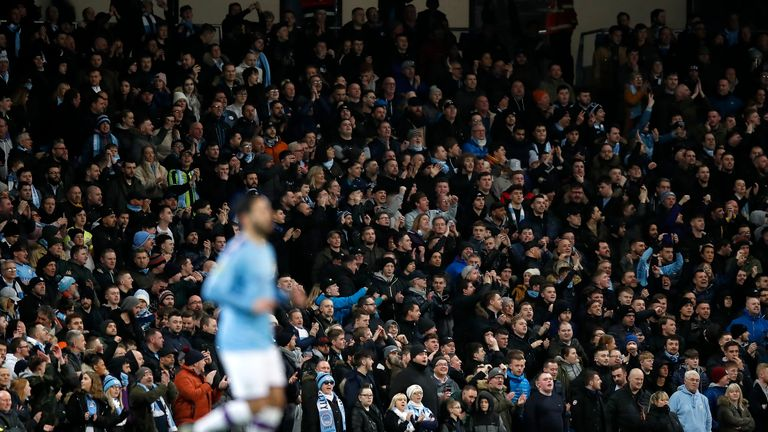 Manchester City fans watch on during the Carabao Cup Semi Final, second leg match at the Etihad Stadium, Manchester.