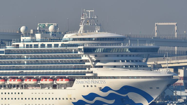 The Diamond Princess cruise ship is seen anchored at the Daikoku Pier Cruise Terminal in Yokohama port on February 13, 2020. - At least 218 people on board a cruise ship quarantined off Japan have tested positive for the novel COVID-19 coronavirus, authorities said February 13 as they announced plans to move some elderly passengers off the ship. (Photo by Kazuhiro NOGI / AFP) (Photo by KAZUHIRO NOGI/AFP via Getty Images)