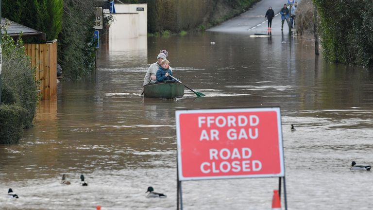 Nearby residents making their way towards Lidl in a canoe in Monmouth, in the aftermath of Storm Dennis.