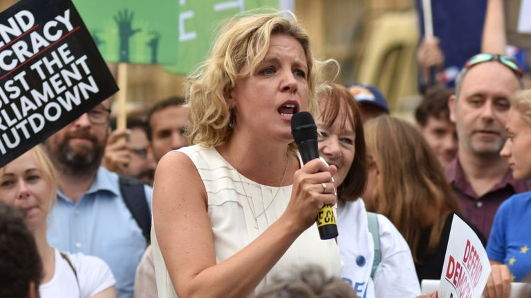 LONDON, ENGLAND - AUGUST 28: Momentum coordinator Laura Parker speaks to protesters as they gather in Westminster to protest against the government proroguing parliament on August 28, 2019 in London, England.