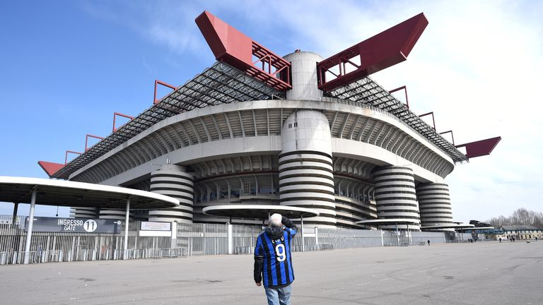A man stands outside the San Siro stadium after the Inter Milan v Sampdoria Serie A match was cancelled due to an outbreak of the coronavirus in Lombardy and Veneto, in Milan, Italy, February 23, 2020.REUTERS/Daniele Mascolo