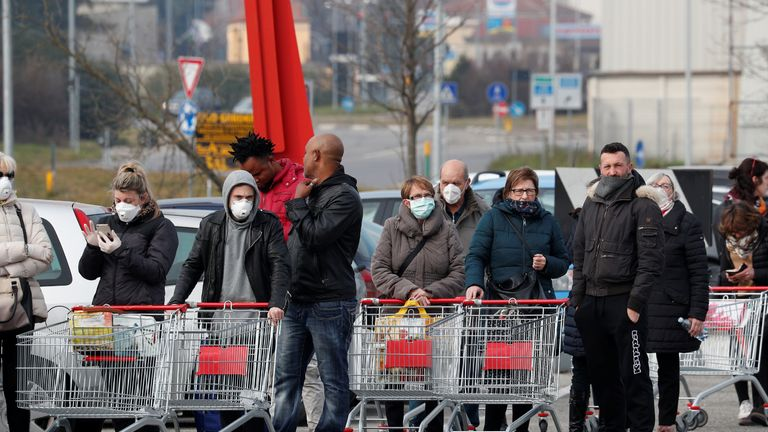 People queue at a supermarket outside the town of Casalpusterlengo, which has been closed by the Italian government due to a coronavirus outbreak in northern Italy, February 23, 2020. REUTERS/Guglielmo Mangiapane