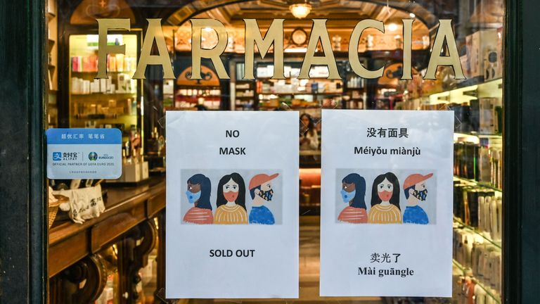 A sign advising clients in various languages, including Chinese, that respiratory masks are sold out, is displayed on January 29, 2020 at a pharmacy in downtown Rome, in the wake of the 2019-nCoV coronavirus, a virus similar to the SARS pathogen, spreading around the world since emerging in a market in the central Chinese city of Wuhan. - The Italian government said on January 29, 2020 it was sending a plane to evacuate citizens from the Chinese city of Wuhan, the epicentre of a deadly SARS-like virus, as WHO chief called new emergency talks on the virus situation. (Photo by Alberto PIZZOLI / AFP) (Photo by ALBERTO PIZZOLI/AFP via Getty Images)