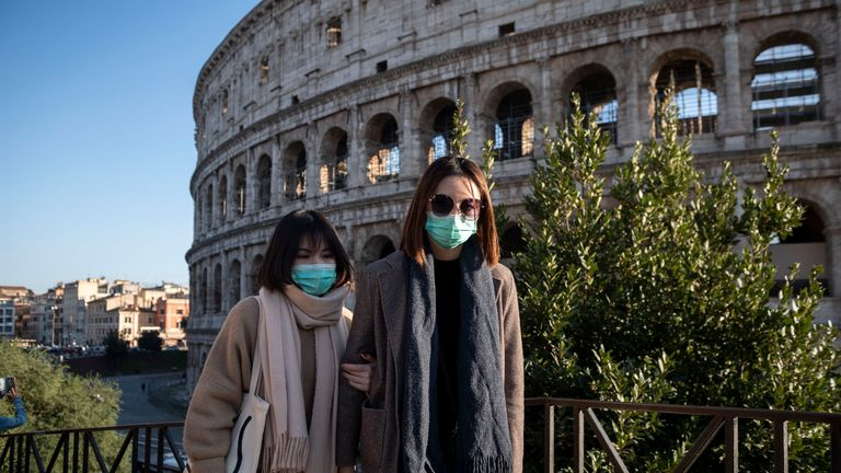 ROME, ITALY - FEBRUARY 24: Tourists wearing face masks visit the Colosseum area on February 24, 2020 in Rome, Italy. The Italian government declared a state of emergency on January 31 and today the coronavirus (Covid-19) has claimed its sixth victim in Italy, an 80-year-old man from Castiglione d'Adda who died in Milan's Sacco Hospital. (Photo by Antonio Masiello/Getty Images)
