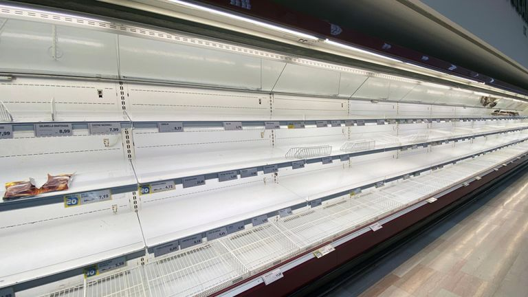 Empty shelves are seen at a supermarket, after a coronavirus outbreak, in Pioltello, near Milan, Italy, February 24, 2020. REUTERS/Flavio Lo Scalzo