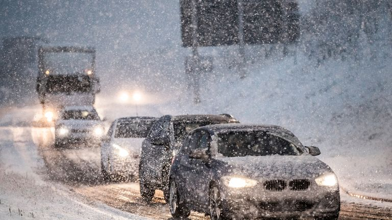 Traffic drives through wintry conditions at Leeming Bar in North Yorkshire after overnight snow hit parts of the UK.