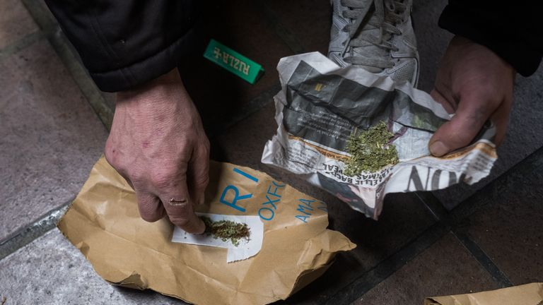 LONDON, ENGLAND - DECEMBER 08: A homeless person rolls up Spice, a synthetic cannabis substitute, into a cigarette while in an underpass by Charing Cross Station on December 8, 2016 in London, England. Homelessness charity Shelter estimates that more than a quarter of a million people have no permanent home. Westminster in London is one of the worst hotspots for homelessness in England with one in 25 without a home according to Shelter figures. (Photo by Jack Taylor/Getty Images)