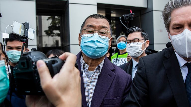 Hong Kong media tycoon and founder of Apple Daily newspaper Jimmy Lai (C) leaves the Kowloon City police station in Hong Kong on February 28, 2020, after being arrested on the suspicion of taking part in an unauthorised assembly on August 31 last year. - Hong Kong media tycoon Jimmy Lai, a high profile critic of Beijing, was arrested on February 28 for taking part in last year's pro-democracy protests that rocked the city for seven months. (Photo by ISAAC LAWRENCE / AFP) (Photo by ISAAC LAWRENCE/AFP via Getty Images)