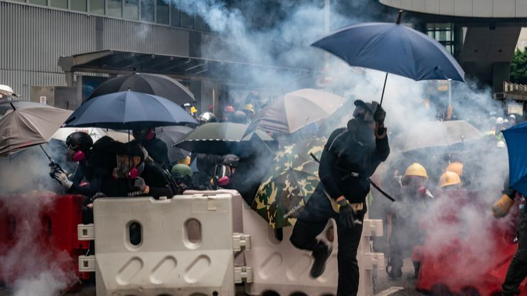 "HONG KONG, CHINA - AUGUST 31:  Protesters throw tear gas canisters back at police during an anti-government rally outside of Central Government Complex on August 31, 2019 in Hong Kong, China. Pro-democracy protesters have continued rallies on the streets of Hong Kong against a controversial extradition bill since 9 June as the city plunged into crisis after waves of demonstrations and several violent clashes. Hong Kong's Chief Executive Carrie Lam apologized for introducing the bill and declared it ""dead"", however protesters have continued to draw large crowds with demands for Lam's resignation and completely withdraw the bill. (Photo by Anthony Kwan/Getty Images)"