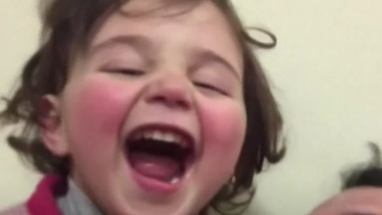 Syrian dad teaches daughter how to cope with bombs - with laughter