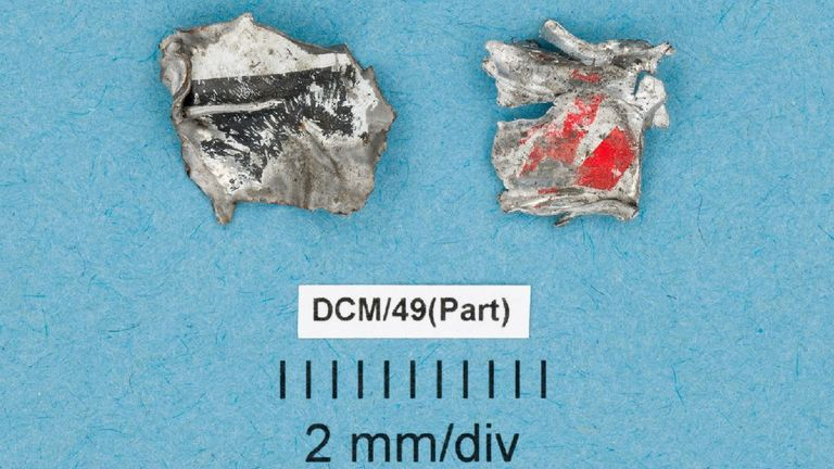 Chunk of paint tin were among the tiny fragments found at the scene. Pic: Greater Manchester Police