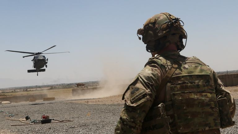 A US soldier watches as a Blackhawk Helicopter prepares to land in southeastern in August 2019