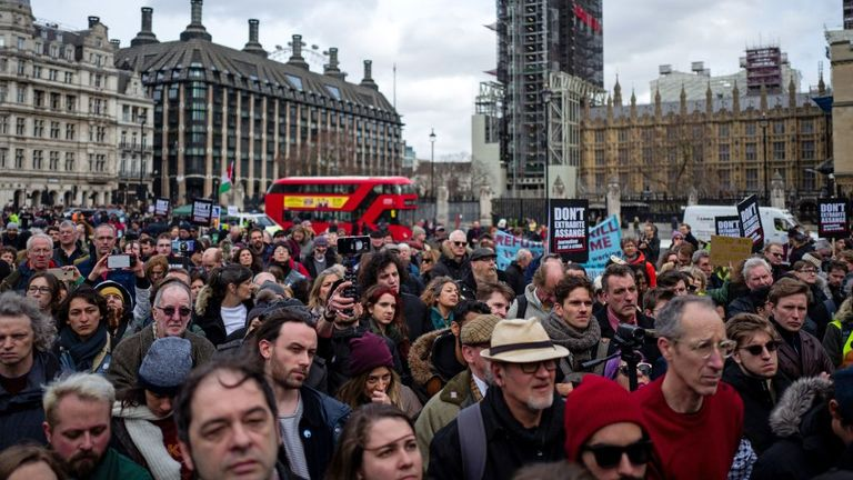 Supporters gather in Parliament Square to listen to speeches after a march in support of Wikileaks founder Julian Assange in London on February 22, 2020, as he fights extradition to the United States. - The main hearing in extradition proceedings against Wikileaks founder Julian Assange begins at the end of February. The United States has been demanding extradition of the 48-year-old Australian for years because of the publication of secret documents and violations of the anti-espionage law. (Ph