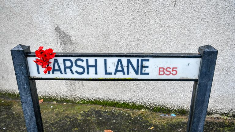 Red flowers also appear on a sign in Marsh Lane