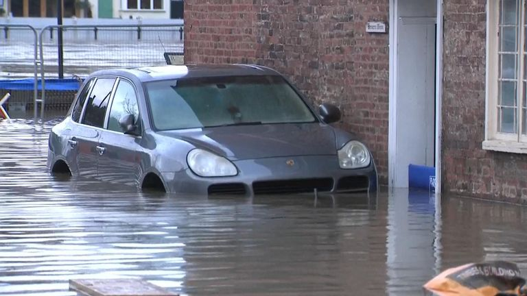 A car is submerged in flood water in Bewdley