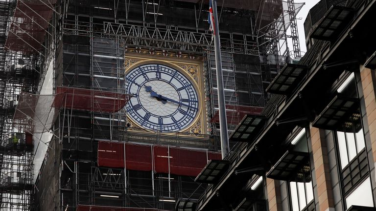 TOPSHOT - The face of the clock in the Elizabeth Tower, better known as Big, is pictured during restoration works at the Houses of Parliament in central London on December 16, 2019